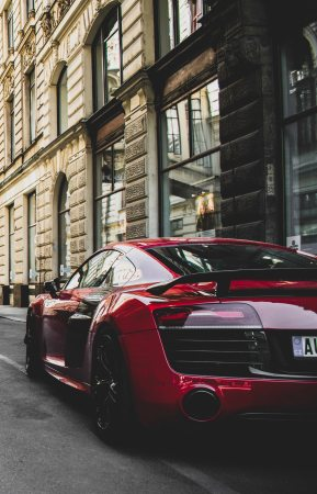 red-and-black-audi-r8-coupe-parked-near-gray-concrete-1545743